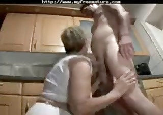 Blonde granny goes down on his cock before