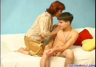 Mature chubby Russian redhead gives this young