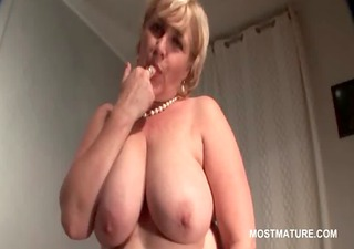 BBW busty mature rides a cucumber in bed