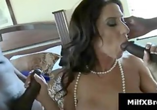 Busty brunette mom gives blowjob in interracial